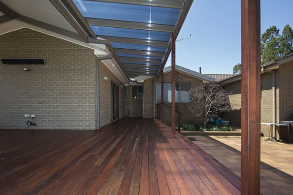 ACT Decks - Kaleen - Deck with two separate pergola coverings, down lights and wide partial wrap-around stairs.