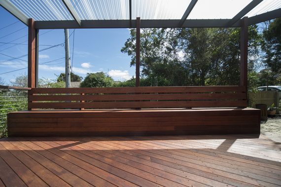 ACT Decks - Hackett - Outdoor entertainment area made of hardwood deck and bench seating with hidden storage.